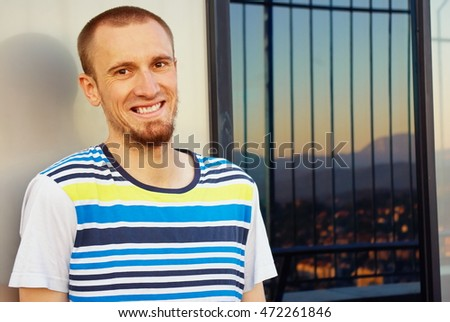Handsome casual man standing on a skyscraper view