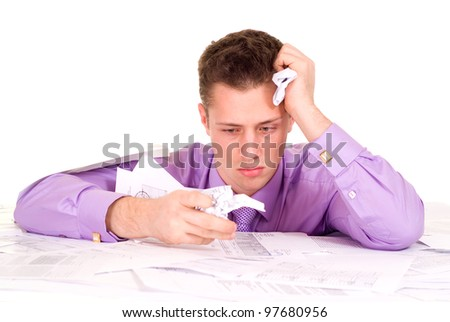 Handsome Caucasian good Business man very emotional in the papers on a light background - stock photo
