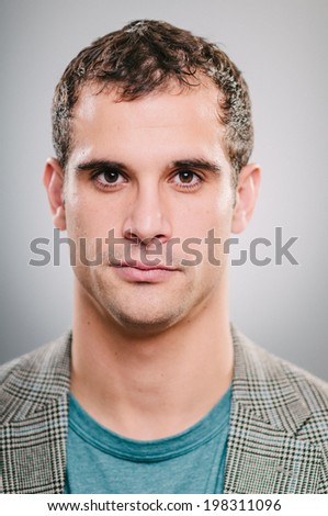 Handsome Caucasian man blank expression portrait - stock photo
