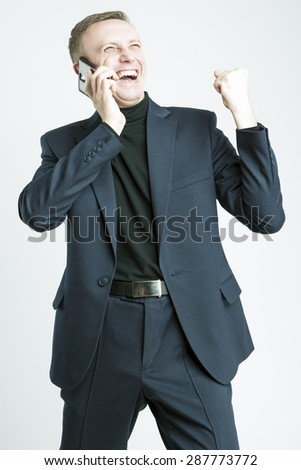 Handsome Caucasian Man In Elegant Suit Speaking Using Cell Phone With Positive Expression - stock photo