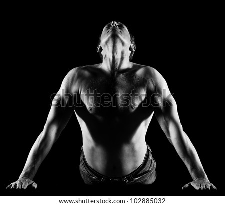 Handsome caucasian man stretching, black and white image front - stock photo
