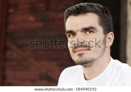 Handsome Caucasian young man in his twenties - stock photo