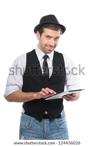 Handsome cheerful man browsing internet with tablet pc. Isolated. - stock photo
