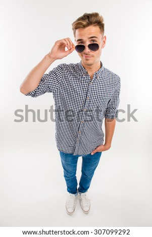 handsome cheerful man in glasses smiling - stock photo