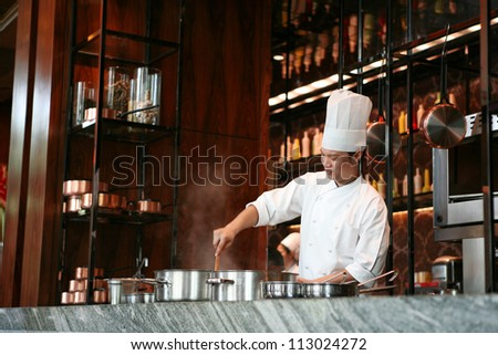 Handsome chef cook delicious food, Thailand - stock photo