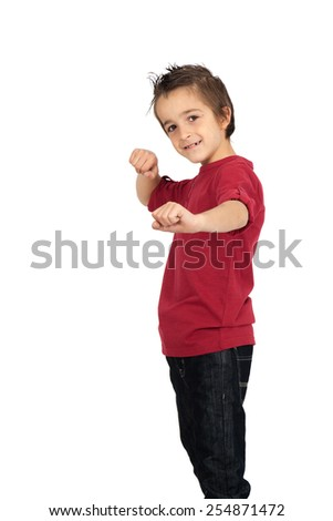 Handsome child doing different expressions in different sets of clothes: boxe - stock photo