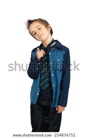 Handsome child doing different expressions in different sets of clothes: pointing - stock photo