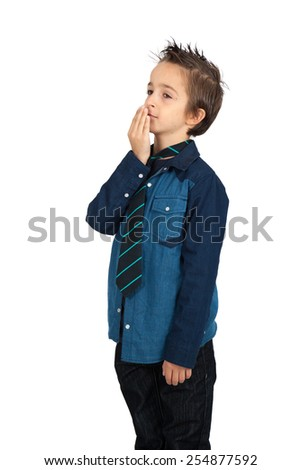 Handsome child doing different expressions in different sets of clothes: yawn - stock photo