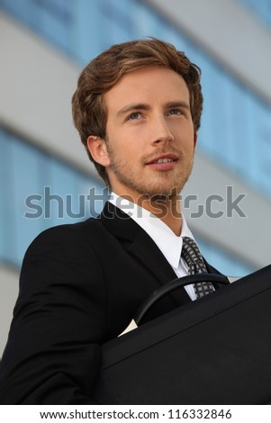 Handsome commuter with briefcase - stock photo