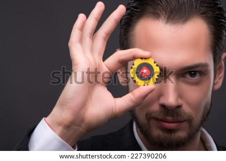 Handsome  confident man   showing ok with  one yellow chip  with copy place - stock photo