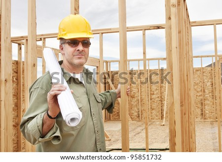 Handsome construction worker building a Home - stock photo