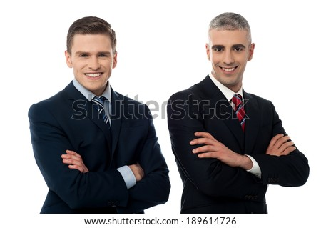 Handsome corporate executives posing confidently - stock photo