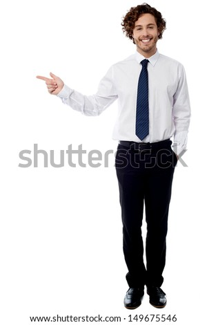 Handsome corporate guy pointing at something - stock photo