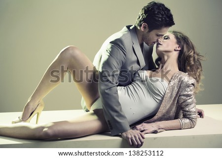 Handsome couple hugging - stock photo