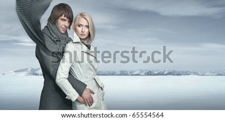 Handsome couple in the winter scenery - stock photo