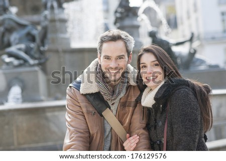 handsome couple portrait with fountain in background