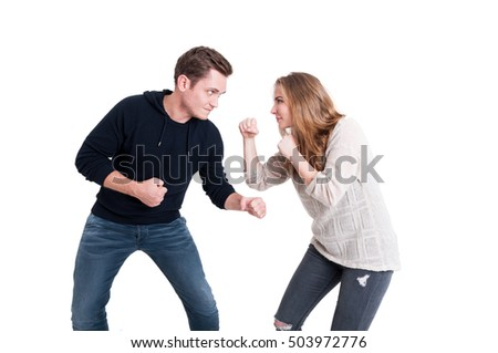 Handsome couple posing like having a fight isolated on white background