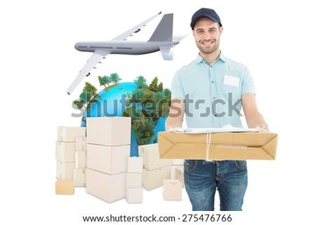 Handsome courier man with parcel against logistics concept - stock photo