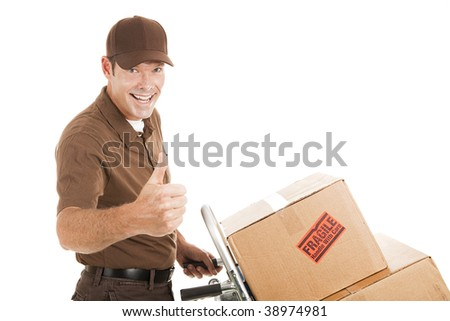 Handsome delivery man with packages on a hand cart, giving a thumbs up.  Isolated on white. - stock photo