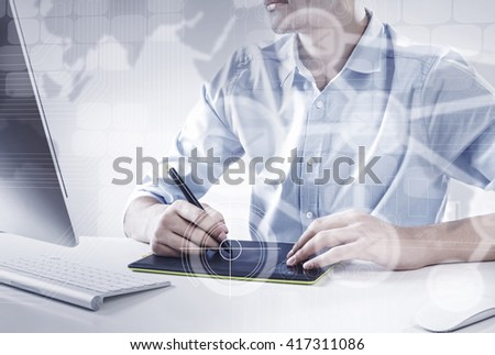 Handsome designer at work - stock photo