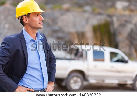handsome determined mine manager visit mining site - stock photo