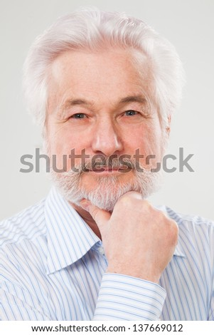 Handsome elderly man with beard isolated over white background - stock photo