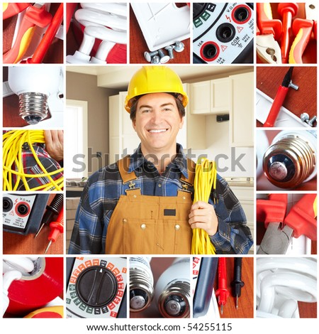 Handsome electrician in yellow uniform - stock photo