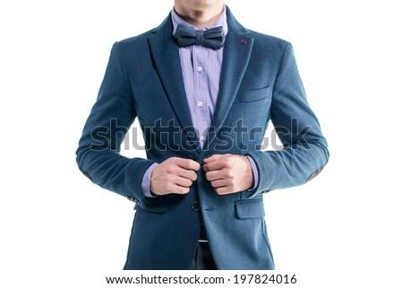 Handsome elegant young fashion man in coat tuxedo classical suit costume and bow tie isolated on white - stock photo