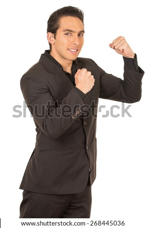 handsome elegant young latin man wearing a suit posing with fists up gesturing fight isolated on white - stock photo