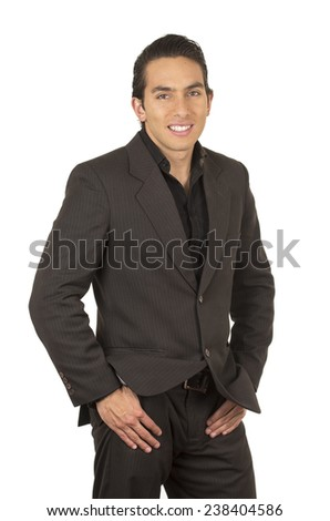 handsome elegant young latin man wearing a suit posing with hands in pocket isolated on white - stock photo