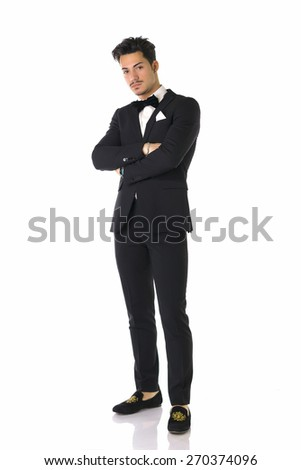 Handsome elegant young man with suit and bow-tie, full length shot, isolated on white