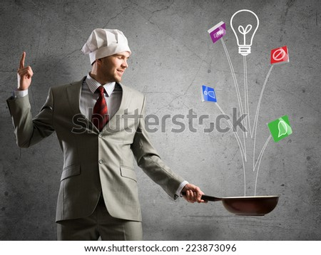 Handsome emotional businessman with pan in hands - stock photo
