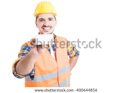 Handsome engineer showing blank business card and smiling on white background with copy space - stock photo