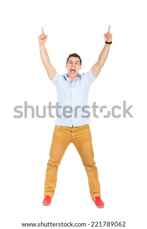 handsome excited man happy smile, raised arms fingers up, young guy casual wear, full length isolated over white background - stock photo