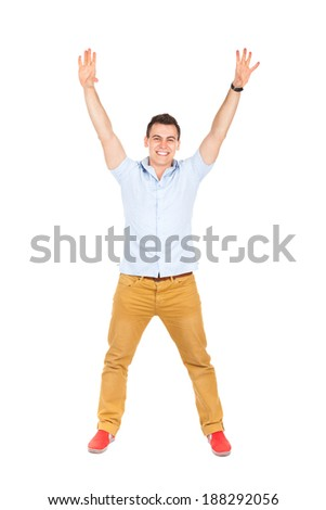 handsome excited man happy smile, raised hands arms palms, young guy casual wear, full length isolated over white background - stock photo