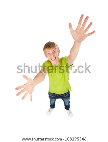handsome excited man happy smile with raised hands arms palms looking at camera, concept top angle full length portrait, above view of young guy wear green t shirt, isolated over white background - stock photo