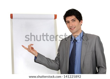 handsome executive pointing at board - stock photo