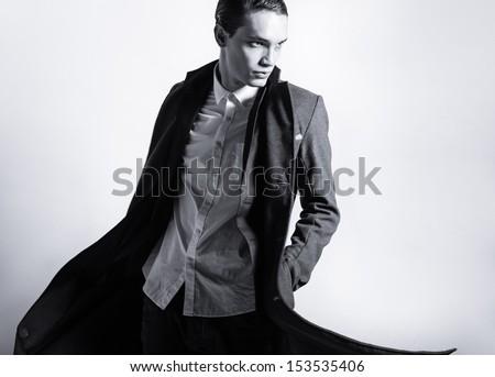 Handsome fashion male model posing in the studio - stock photo
