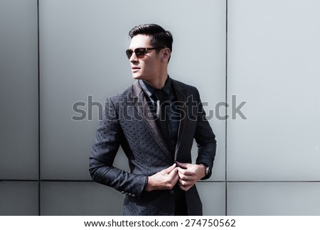 Handsome fashion model in a suit.  - stock photo