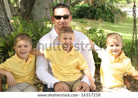 Handsome father with happy boys - stock photo