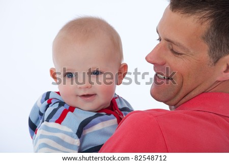 Handsome father with his happy smiling baby son - stock photo