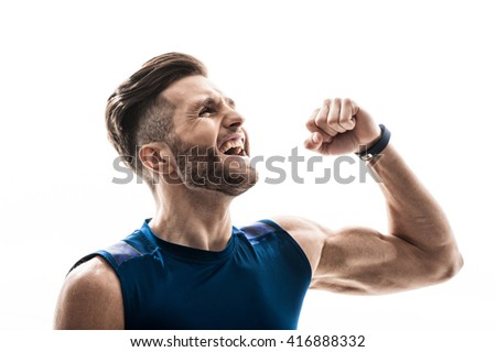 Handsome fit athlete is happy for his victory - stock photo