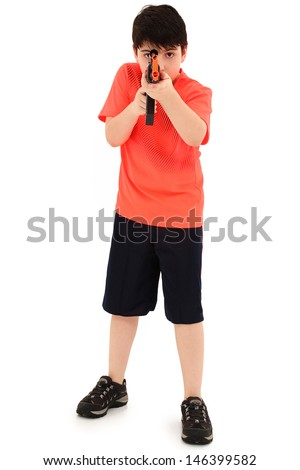 Handsome French American Boy Aiming Plastic Toy AK47 Towards Cam - stock photo