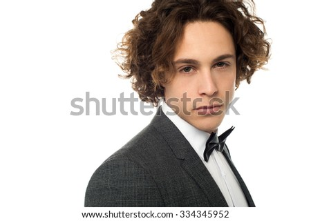 Handsome groom giving a tough look - stock photo