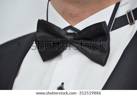 Handsome groom with black bow
