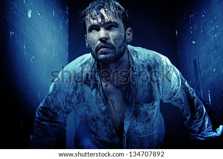 Handsome guy in a dirty white shirt - stock photo