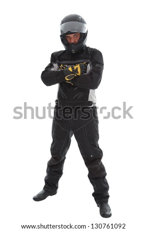 Handsome guy in motorcycle clothes and helmet, studio shot - stock photo