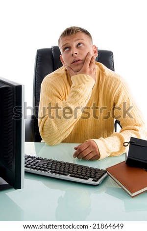 handsome guy in thinking pose in an office - stock photo