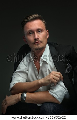 Handsome guy in white shirt and in suit. Isolated on grey - stock photo