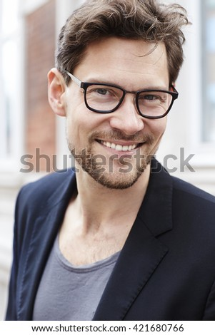 Handsome guy smiling in spectacles, portrait - stock photo